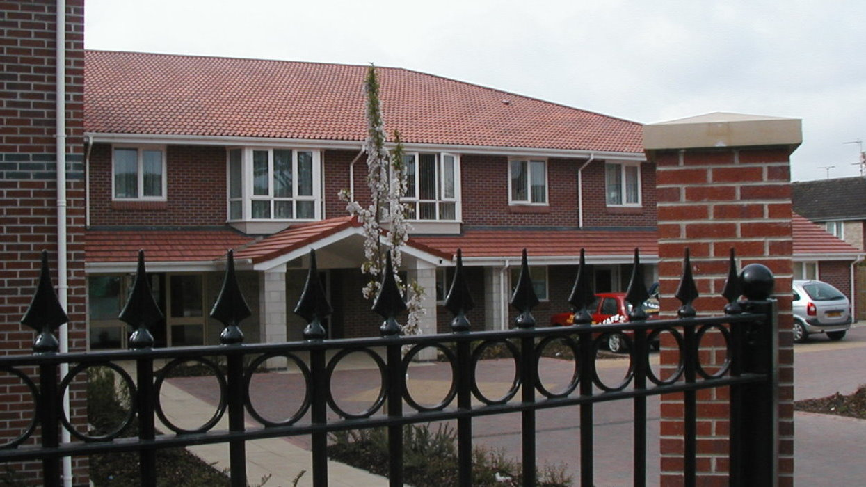 View of apartments with fence infront