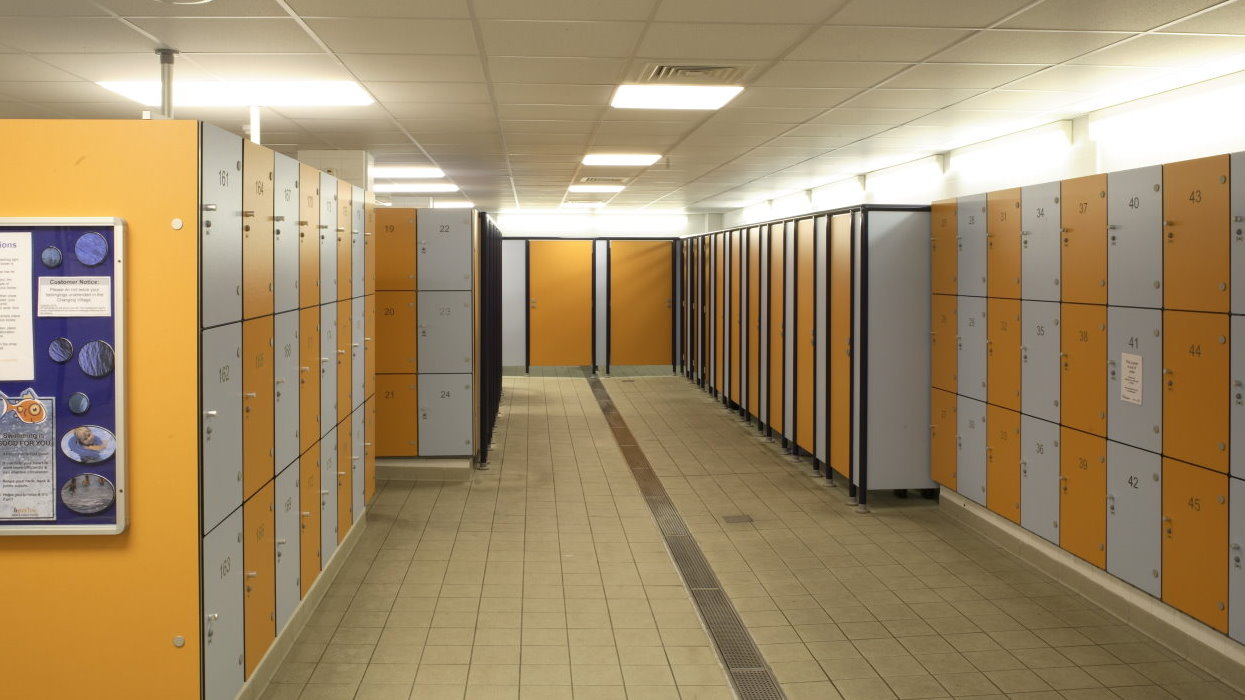 View of changing rooms with coloured lockers either side