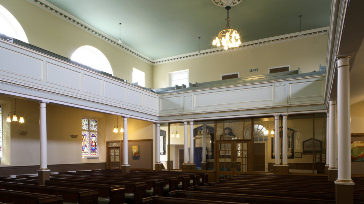 View looking to back of church over the pews