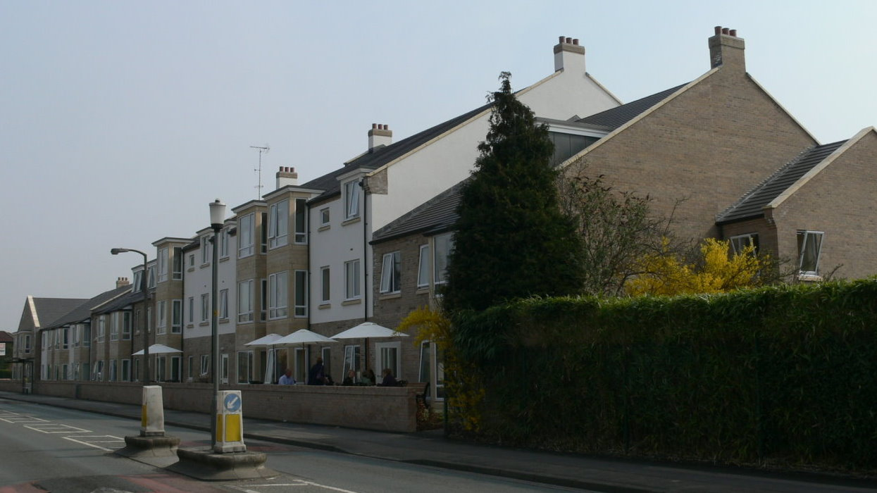 View along front of buildings from road