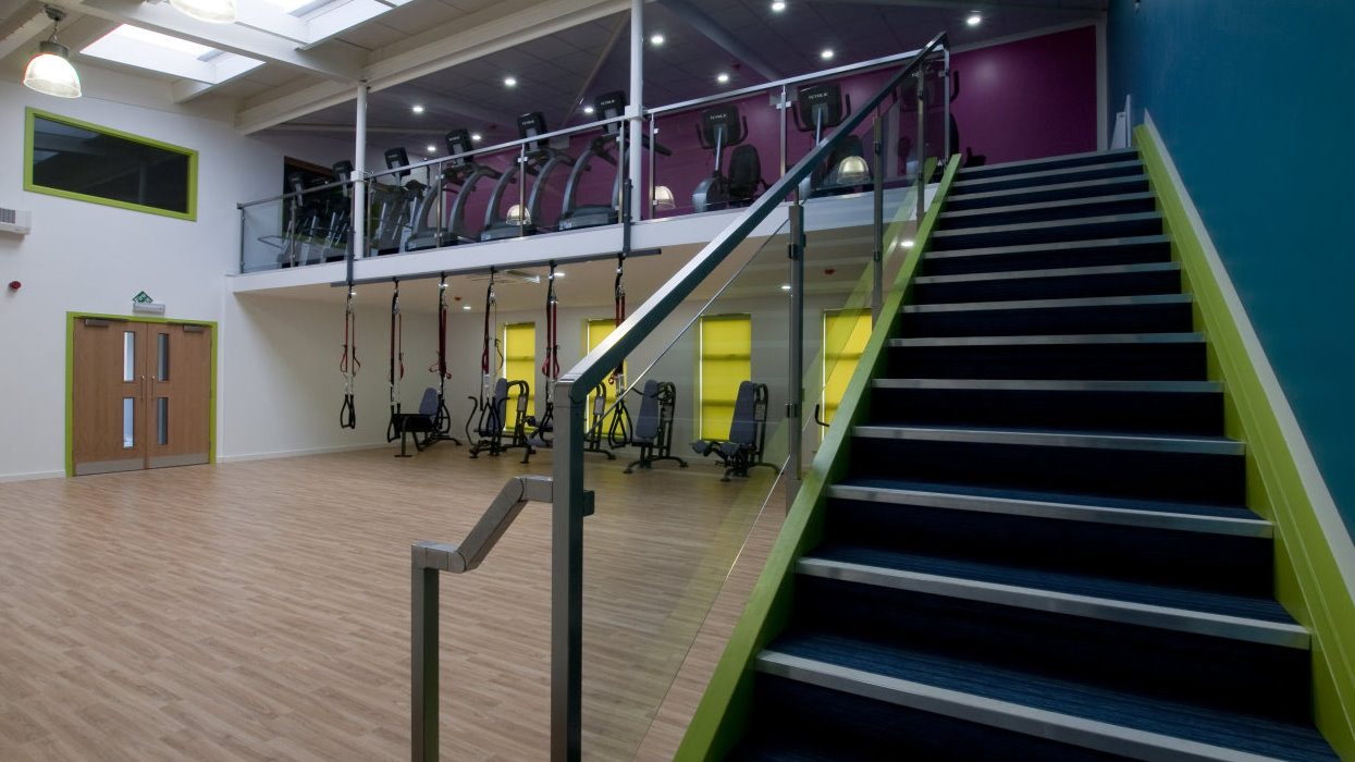 View across sports hall and up stairs