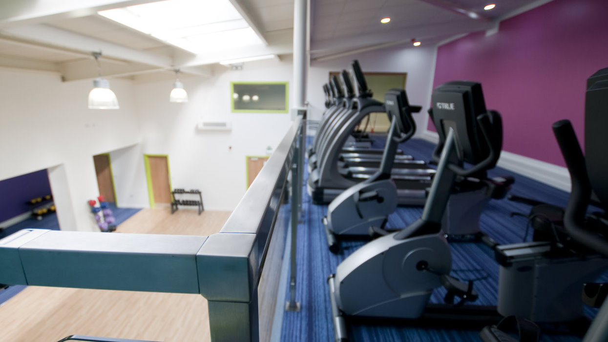 View with exercise bike and down over the sports hall